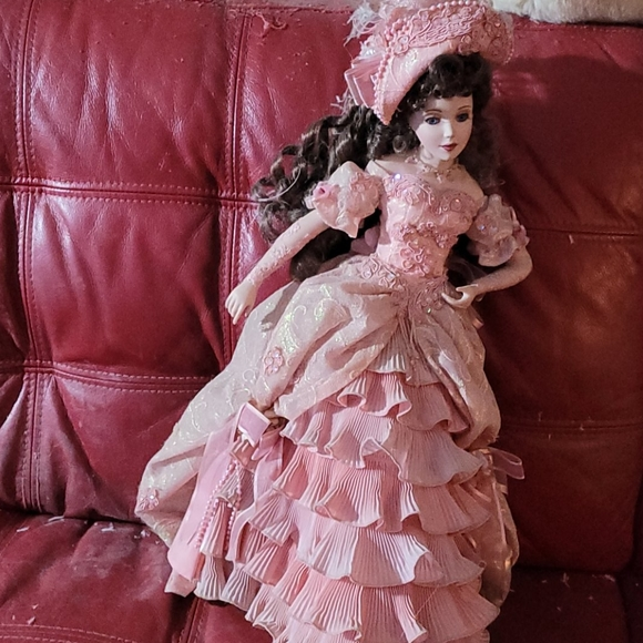 Porcelain doll 23 inches in height